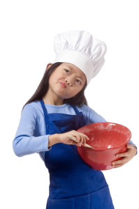 young girl having fun in the kitchen picture